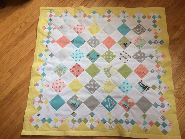 Love this pretty, cheery little pattern!  Used a charm pack and had just enough for the 5 1/2' squares and strips for the little 9-patches.  Will give to a special baby who is yet unborn.
