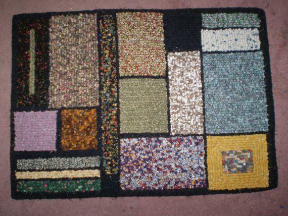 Locker hooked rug--Love the Mondrian-like design!