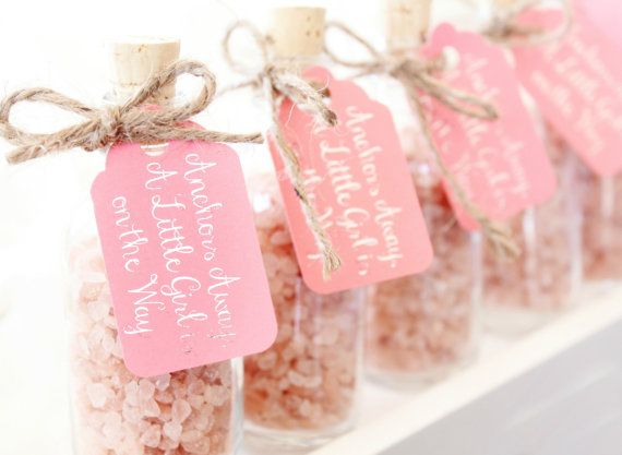 Little glass bottles are filled with pink Himalayan sea salt to offer you a baby shower favor that is rustic, feminine, and just a little bit beachy. This pink salt is rumored to be the purest form of sea salt available anywhere in the world and is rich in minerals. Gift these bottles to your baby shower attendees and let them enjoy the salt of the ocean in their bath water for a truly oceanic experience.  #theseaglassseahorse
