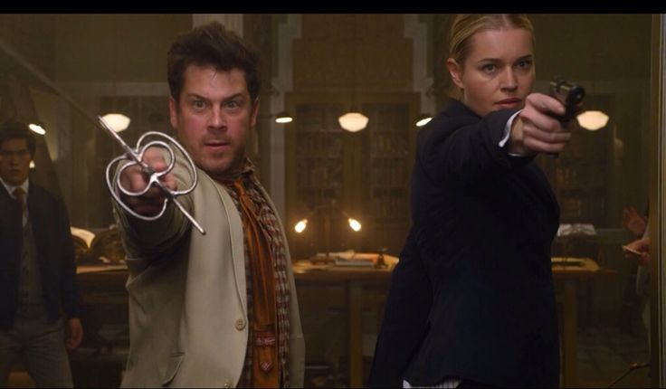 Jacob Stone (Christian Kane) & Col. Eve Baird (Rebecca Romijn)   The Librarians and the Horns of a Dilemma.