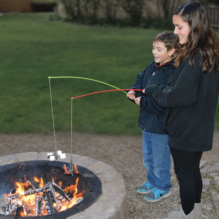 The Campfire Roasting Rod - This is the patented counterbalanced campfire set that enables campers to roast hot dogs and toast marshmallows from a safe distance as if fishing. - Hammacher Schlemmer