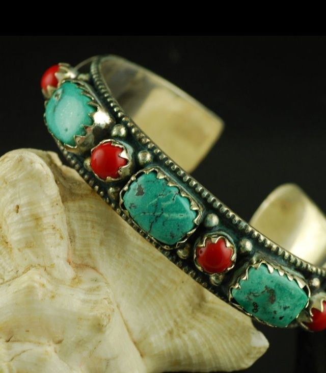Sterling silver, turquoise and coral navajo bracelet.