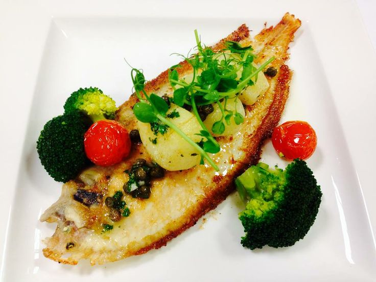 Pan fried whole plaice, served on bone with steamed broccoli, new potatoes and caper dressing