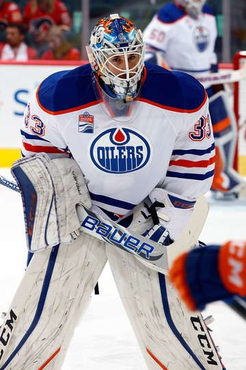 CALGARY, AB - OCTOBER 14: Cam Talbot #33 of the Edmonton Oilers skates in the warmup before an NHL game against the Calgary Flames on October 14, 2016 at the Scotiabank Saddledome in Calgary, Alberta, Canada. (Photo by Gerry Thomas/NHLI via Getty Images)