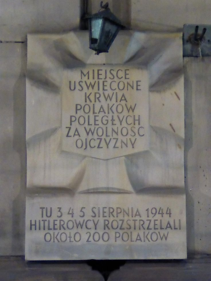 """A """"Tchorek plaque"""" on Marszałkowska Street. This plaque commemorates the 200 people who were murdered here by the Germans in August 1944...."""
