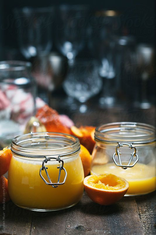 Seville orange curd in glass jars. by Darren Muir. Available to licence on stocksy. DARRENMUIR20 for 20% discount on checkout. #discount #code #stocksy #stock #photography #Seville #orange #curd #dark #food