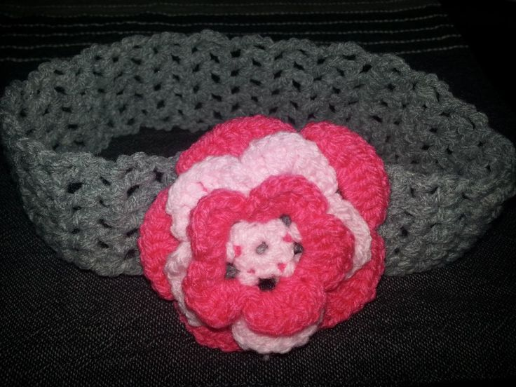 Crochet hairband with a crochet flower.