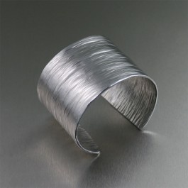 Radiant in highly polished #Aluminum, this Bark #Cuff is an accessory standout. The eye-catching look is due in large part to the hand-hammered texturing that gives this cuff an unforgettable contemporary design that looks simply magical.: Wedding Anniversary, Awesome Cuffs, Handmade Aluminum, Awesome Aluminum, Aluminum Cuffs, Beautiful Aluminum, Bark Cuffs, Aluminum Bark, Aluminum Jewelry