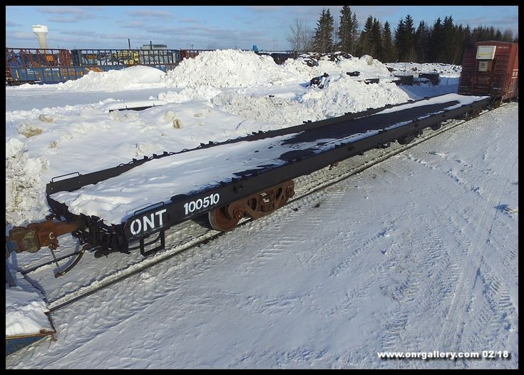 Ontario Northland's new 'strap' cars 100507 & 100508 are currently working non-stop on the 421-622 Polar Bear while 100509 is currently under construction in Cochrane Shops. On Feb. 6th we catch 100510 after arriving from North Bay completely stripped of her original decking and painted in a coat of flat black ready for her turn to be customized as a 'strap' car.