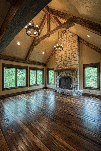 Beautiful living room! Love the floors, stone, and beams