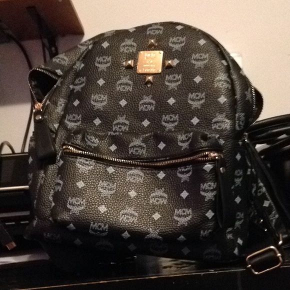 Black MCM bag Perfect condition MCM bag. Price reflect authenticity MCM Bags Backpacks
