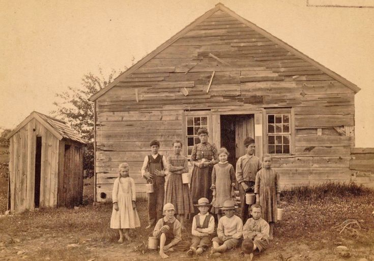Old School House 1800's - notice most of the children are holding lunch pails.