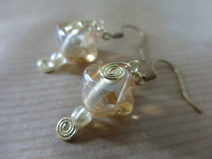 Earrings: Champagne Glass Beads With Champagne Gold Wire Spirals by TheCatAndTheClasp on Etsy