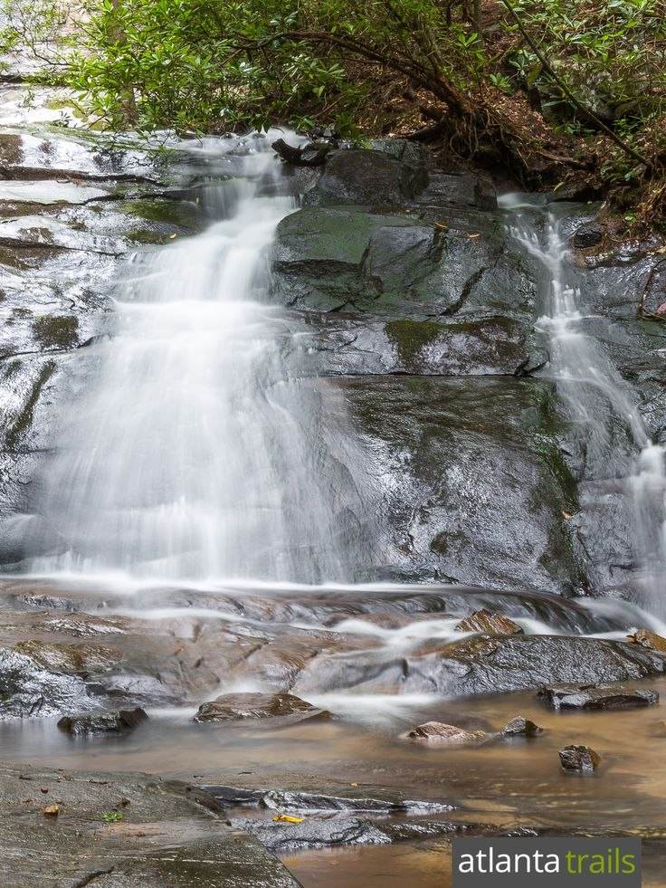 Fall Branch Falls spills over a large rock outcrop in a shady, beautiful North Georgia forest