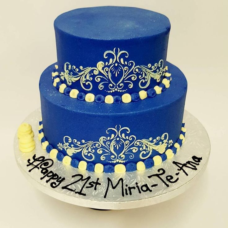 Two tier deep blue cake with cream stencil