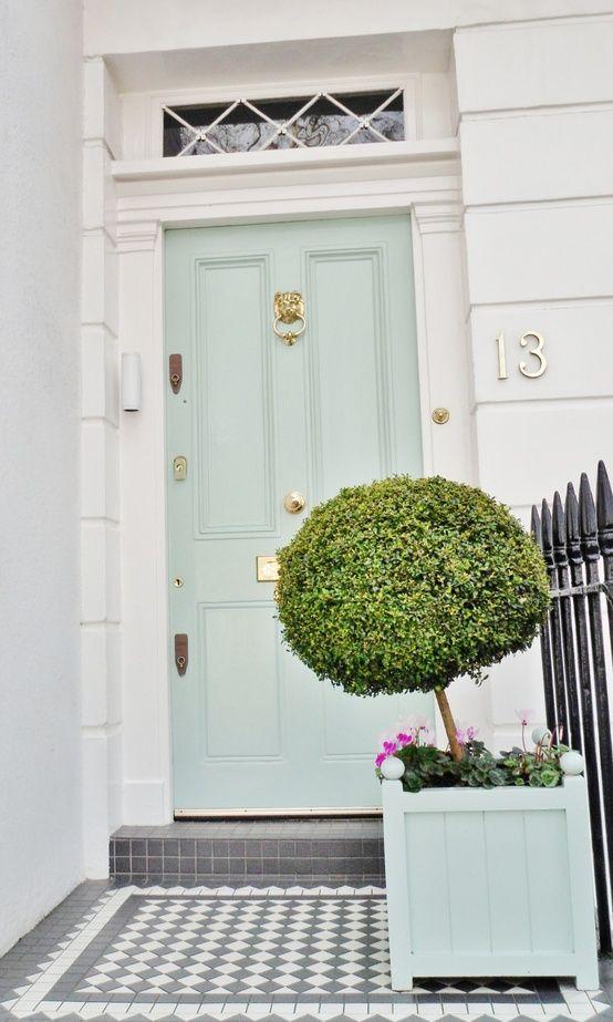 LOVE this - door color, door hardware, door paneling, gray tile, window over the door, plant, planter, everything. (via Marcus Design: {minty fresh ...})