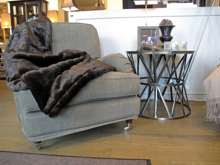 Grey armchair and small sidetable.