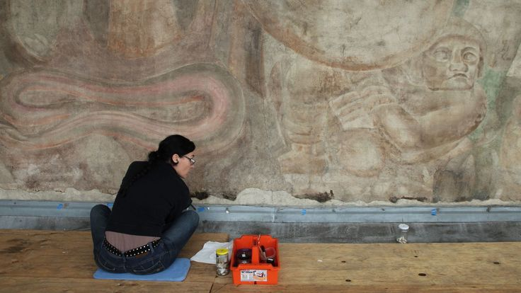 Olvera Street's David Alfaro Siqueiros mural, unearthed from a whitewashing in 2010, is receiving a cleaning courtesy of Getty conservators.