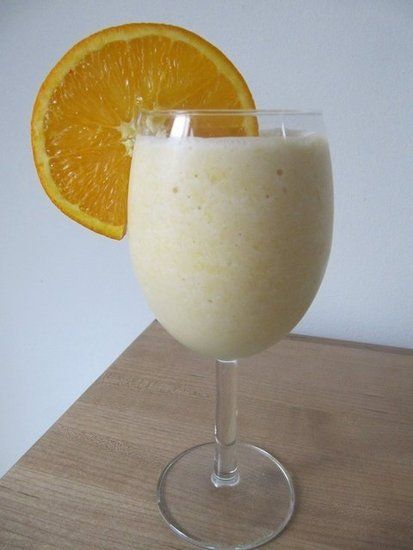Vegan Creamsicle Smoothie; Whether it's a Creamsicle or an Orange Julius, there is something about a dairy-rich orange treat that screams summertime! The fresh orange juice, coconut milk, and protein powder in this orange creamsicle smoothie makes for a refreshing way to recover after an outdoor workout