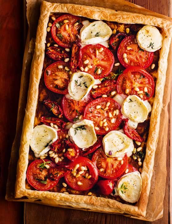 Tomato and goats' cheese tart Could replace the pastry with Cauliflower crust. :)