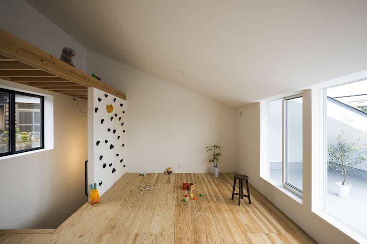 rock climbing wall leading to a multi-use loft - playroom #kids