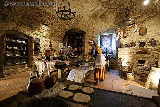 woman-cooking-in-medieval-kitchen-2.jpg cooking, europe, horizontal, images, kitchen, materials, medieval, people, slovakia, spis castle, stones, womens