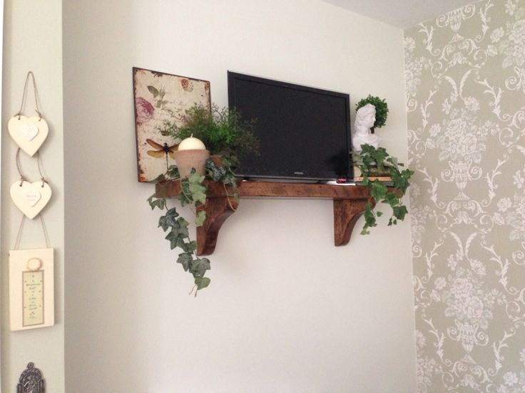 Rustic kitchen shelf for the tv.