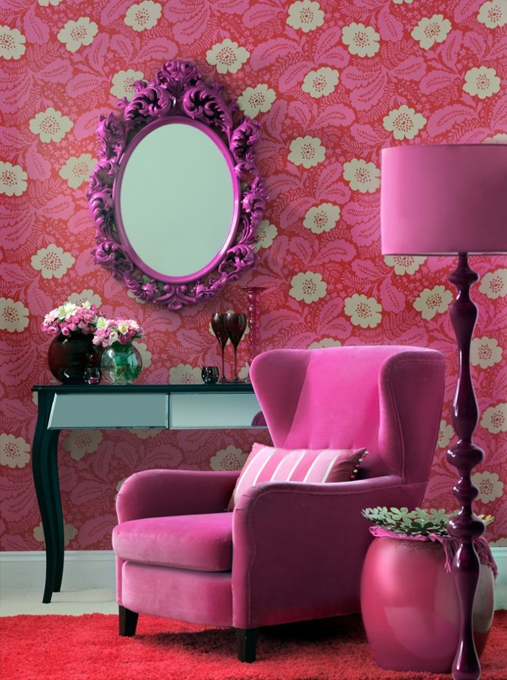 Bold pink wallpaper in this living room