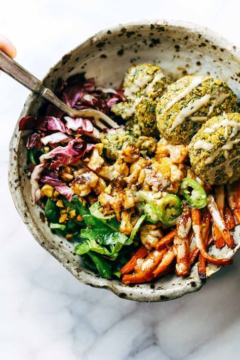 Keep your glow all through winter! Easy homemade falafel, roasted veggies, and flavorful sauce all in one big bowl! vegetarian / vegan / gluten free recipe.