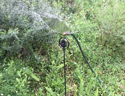 Decorative steel stand with a brass 180 degree fan sprayer.