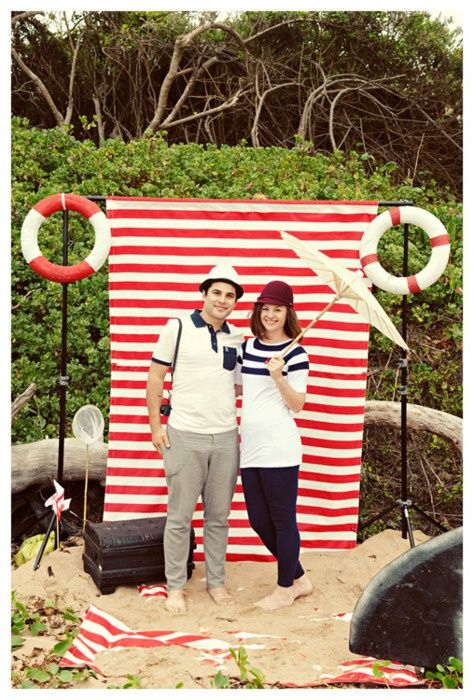 Photo booth would be awesome.  Use a striped sheet (blue and white, or white and red) and see if we have any props.