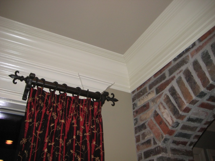 Love the idea of these mini curtain rods on either side of a big window