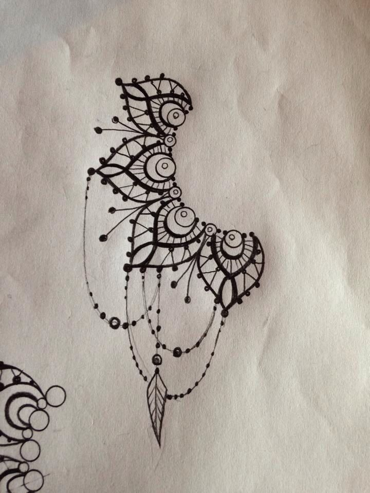 Ear chandelier tattoo