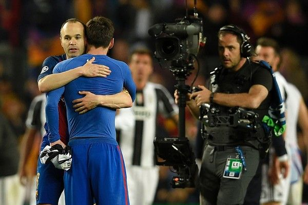 Barcelona's midfielder Andres Iniesta (L) with Barcelona's Argentinian forward Lionel Messi (R) after during the UEFA Champions League quarter-final second leg football match FC Barcelona vs Juventus at the Camp Nou stadium in Barcelona on April 19, 2017. / AFP PHOTO / LLUIS GENE