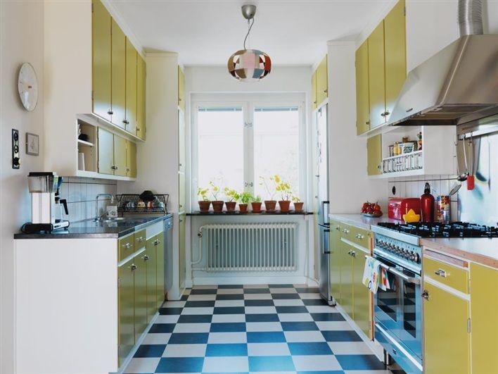 Beautiful, vibrant yellow white and blue kitchen. So fun!