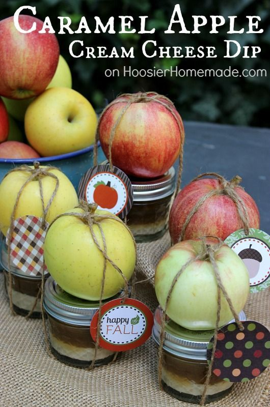 "Send your Thanksgiving day guests home with a delicious and adorable DIY party favor. This dessert recipe for Caramel Apple Cream Cheese Dip has all your favorite fall flavors and looks great put in a jar, wrapped with twine, apple, and ""Happy Fall"" tags—the perfect fall gift idea!"