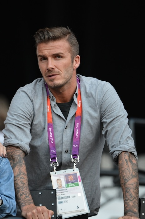 David Beckham .....this is the new hair cut I want. I'm not sure if it has a name so it's hard to find pics for reference.