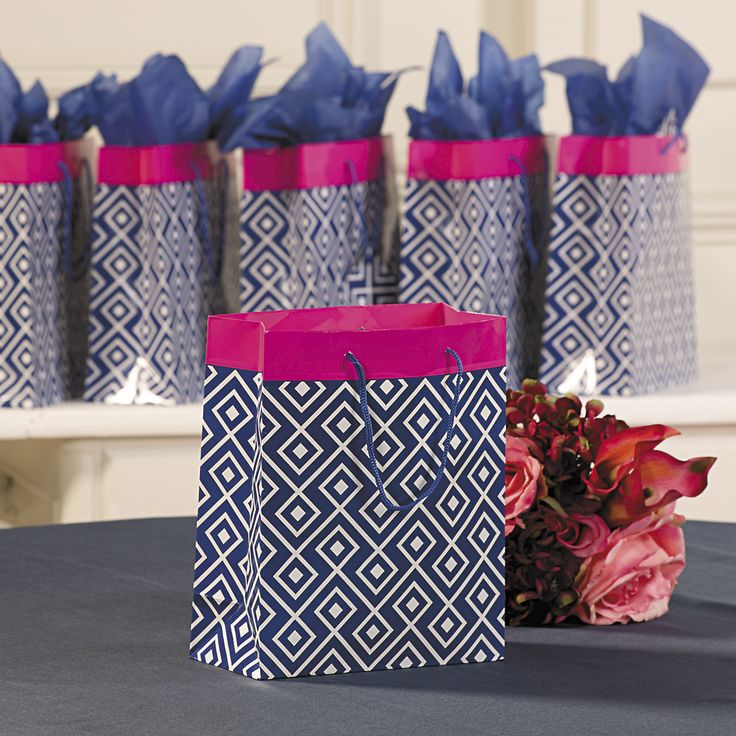 From bridal shower gifts to special bridal party presents, these eye-catching wedding navy blue gift bags with hot pink trim are an easy way to give gifts a stylish wrapping.
