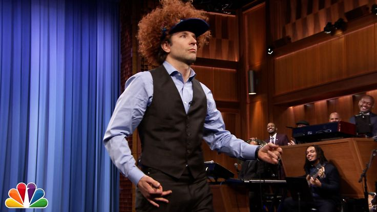 "During a recent appearance on The Tonight Show Starring Jimmy Fallon, actor Bradley Cooper dons a ridiculous wig hat and expertly rocks an air guitar solo along with the Neil Young song ""Down by th..."