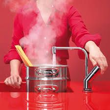 A boiling water tap is on my wishlist - yet more clutter (this time the kettle!) will be banished from the worksurfaces :)