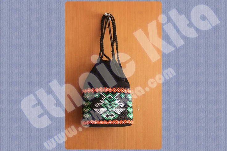 "Beaded Shoulderbags with ""Borneo Motif"".    Measurements : Hight: 20cm x Width: 16cm   Material : Beadeds from kalimantan   Basic Color : White   Motif : Blue sky and pink borneo motif   Ethnic Of : Kalimantan, Indonesia"