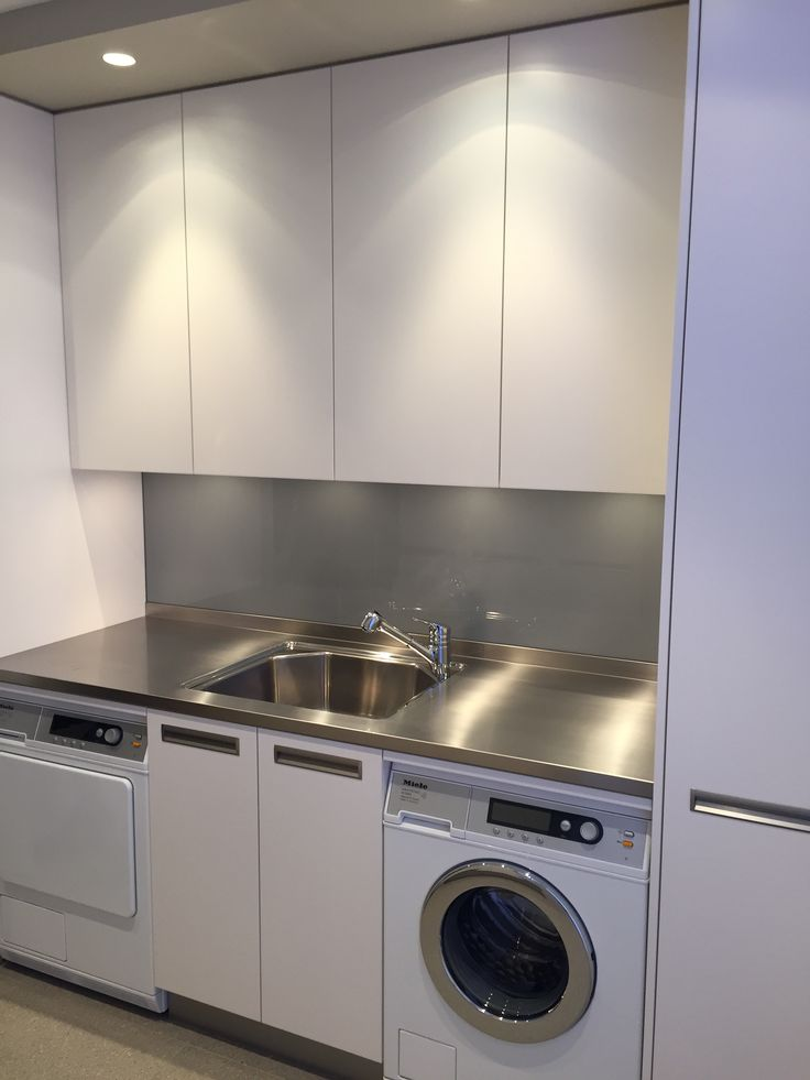 Laundry Shark tooth stainless steel top with matte white cupboards