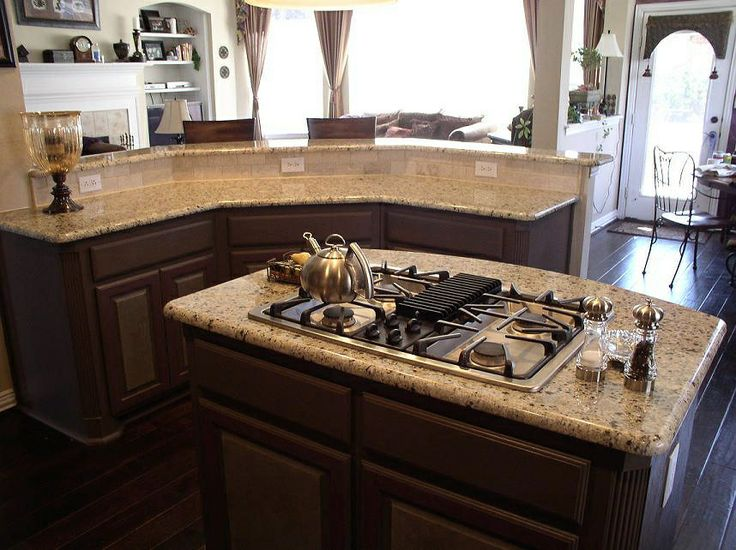 New Venetian Gold Granite With Dark Cabinets