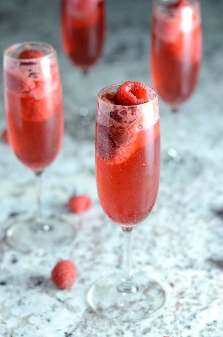 Amazing Raspberry Bellini - a delicious way to celebrate valentine's day or even a random weeknight evening. Such a fun and easy cocktail to make.