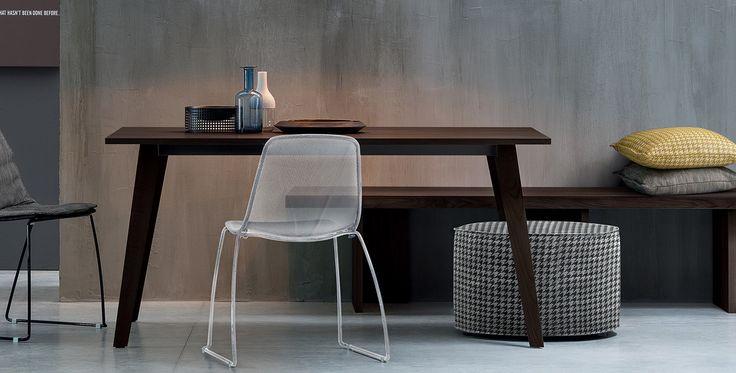 Volta, Tables and chairs, Products   Volta has an original style which gives uniqueness to any domestica context. Design by #Novamobili. #home #decor #livingroom #italian #style #design #table #interiors #architettura #interni #arredo #materiali #furniture