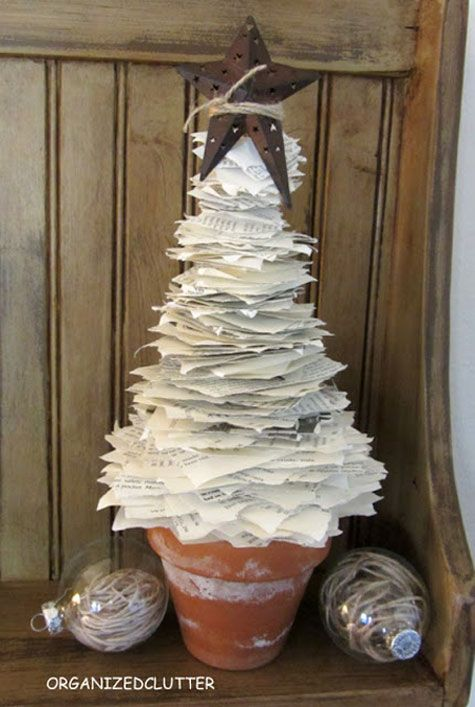 Christmas Crafts: Tear into a book to create this whimsical Christmas tree. This is another great recycling project. It's made from the torn pages of an old book.  I'll be using old math textbooks!!