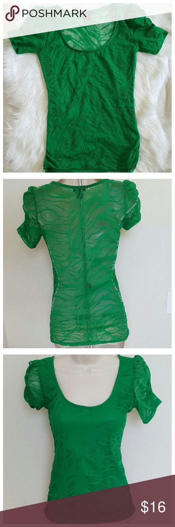 NWOT Green Lace Short Sleeve St. Patty's T-Shirt Short sleeved top from Wetseal, small. Green lace. Including all measurements in the pics. Made in USA! 95% Polyester/5% Spandex. Perfect for St. Patrick's Day! This is absolutely adorable lace top with see through back side. New without tags. Re-posh due to sizing, I have taken pics of measurements to assure best fit for its new home. Wet Seal Tops Tees - Short Sleeve