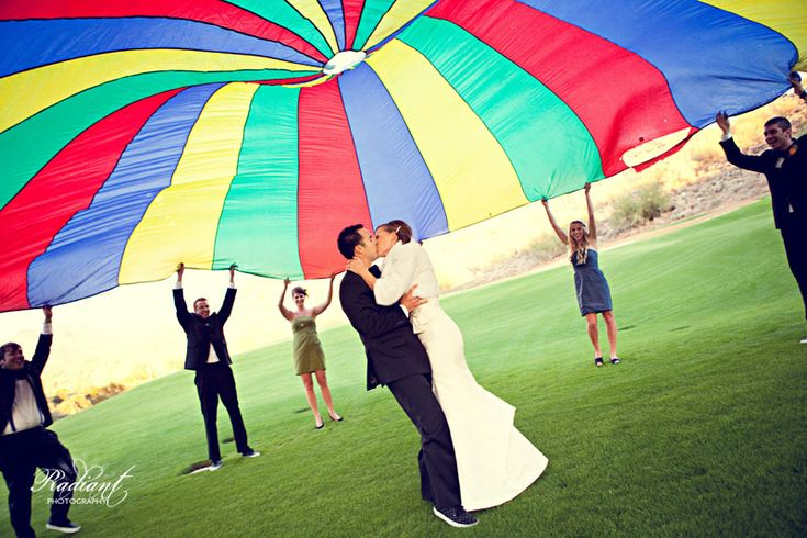 One of this couple's many unique wedding ideas was to bring an elementary school parachute to play with during bridal party picture time at their wedding! Love it! www.thechansons.com/?p=7837    #bridalparty #unique #photos