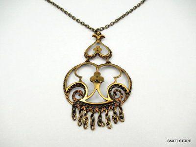 Cast bronze two-piece pendant with a bronze necklace. Designed bij Jorma Valo for his studio Valo-Koru in a distinctive naturalistic design.
