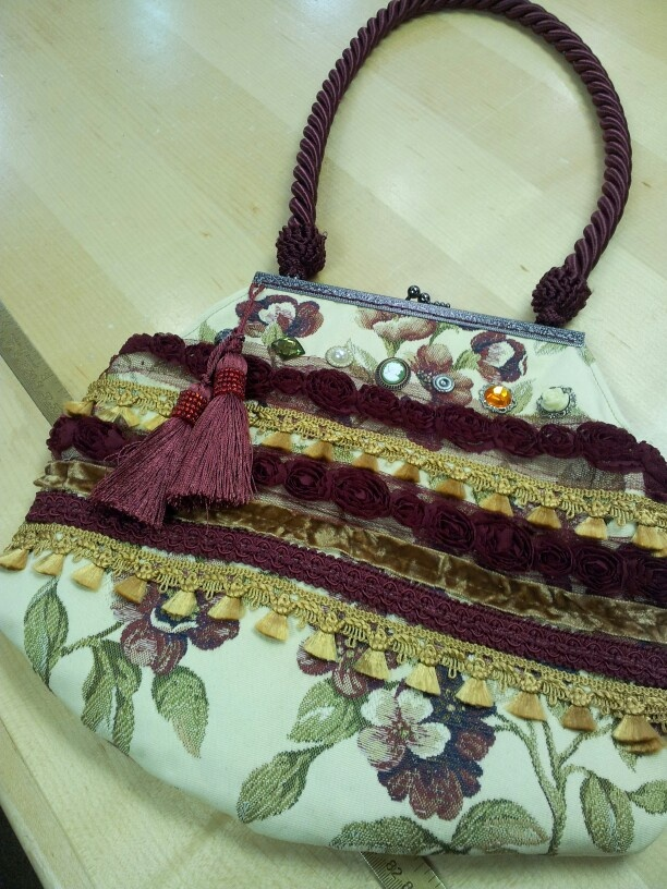 Bag with trims and buttons